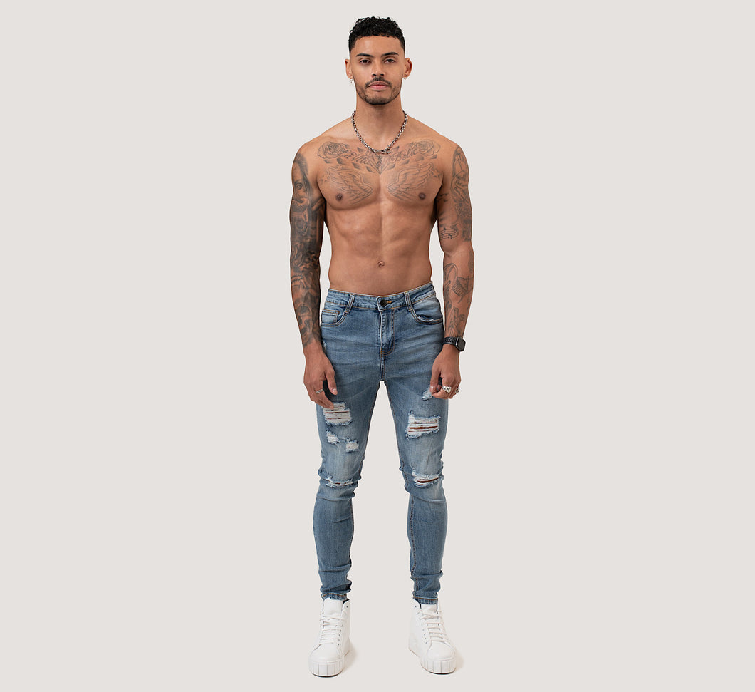SKINNY RIPPED-REPAIRED JEANS - FADED BLUE