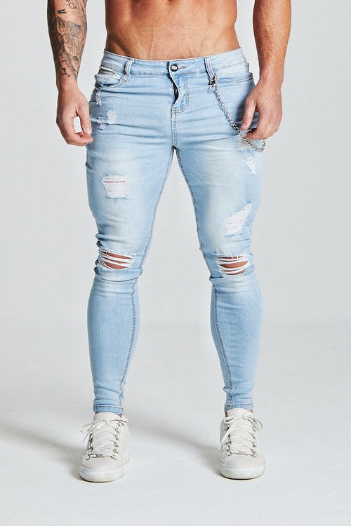 SKINNY RIPPED-REPAIRED JEANS - LIGHT BLUE