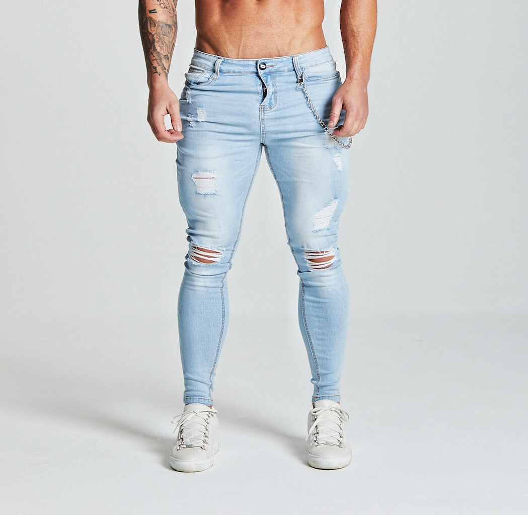 SKINNY FIT RIPPED-REPAIRED JEANS - LIGHT BLUE