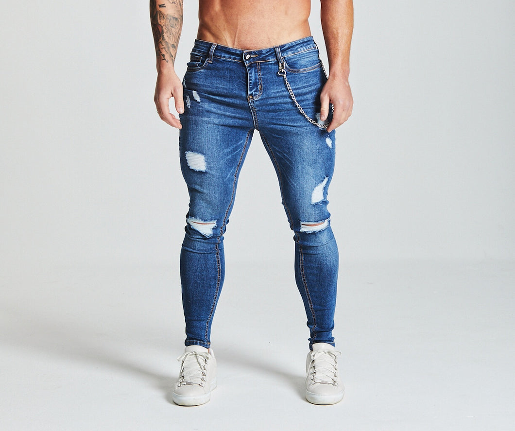 SKINNY FIT RIPPED-REPAIRED JEANS - DARK BLUE