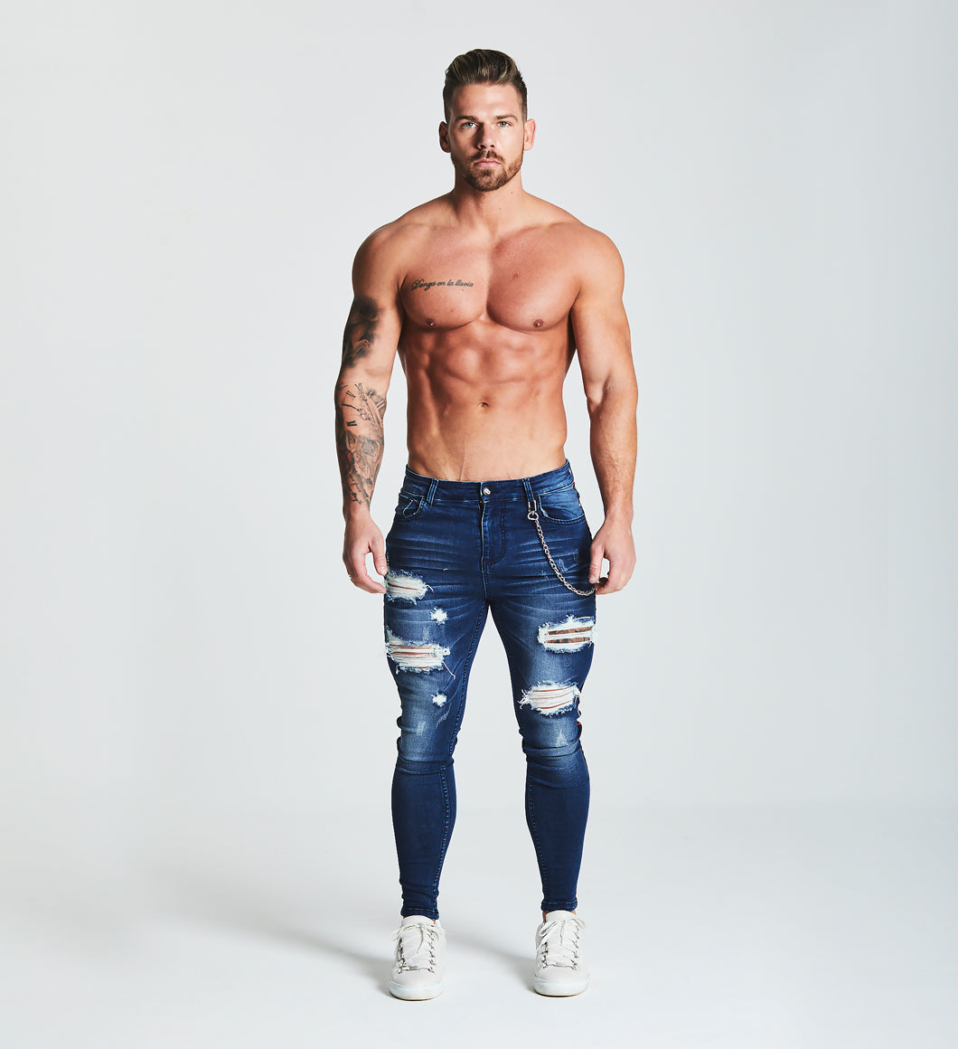 SKINNY FIT RIPPED-REPAIRED STRIPE PANEL JEANS WITH CHAIN - DARK BLUE