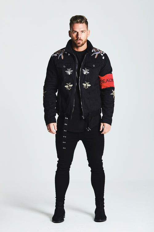 SHEARLING LINED TRUCKER DENIM JACKET WITH RED ARMBAND - BLACK