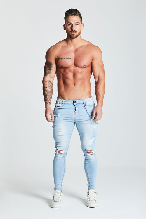 SKINNY FIT RIPPED-REPAIRED JEANS WITH CHAIN - LIGHT BLUE