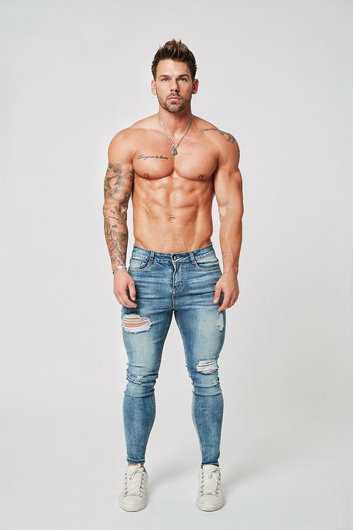 SKINNY FIT RIPPED-REPAIRED JEANS - PALE BLUE