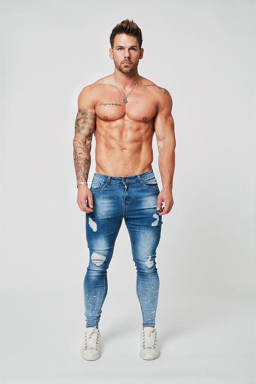 SKINNY FIT RIPPED-REPAIRED JEANS - GRADIENT FADE DARK BLUE/PAINT SPRAYED