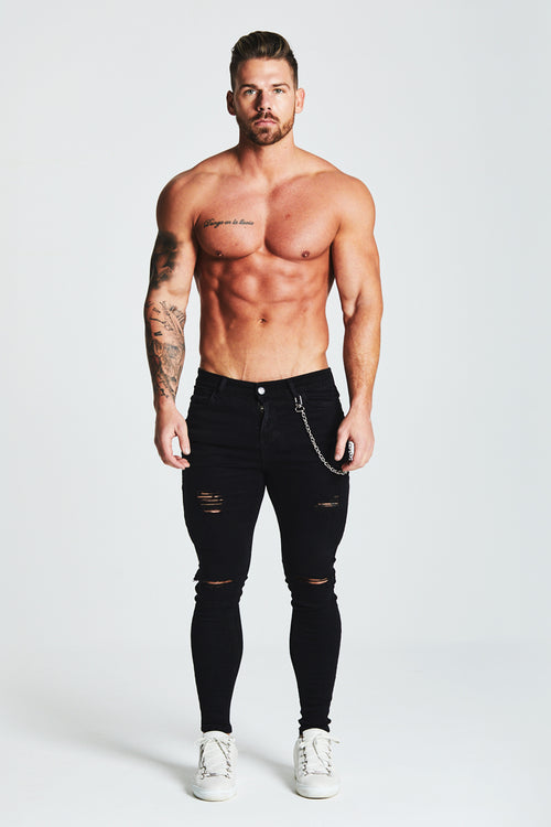 SKINNY FIT RIPPED-REPAIRED JEANS WITH CHAIN - BLACK