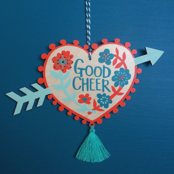 Laser cut and screen printed 'Good Cheer' Milagro charm by Fiona Biddington aka Paper Argonauts