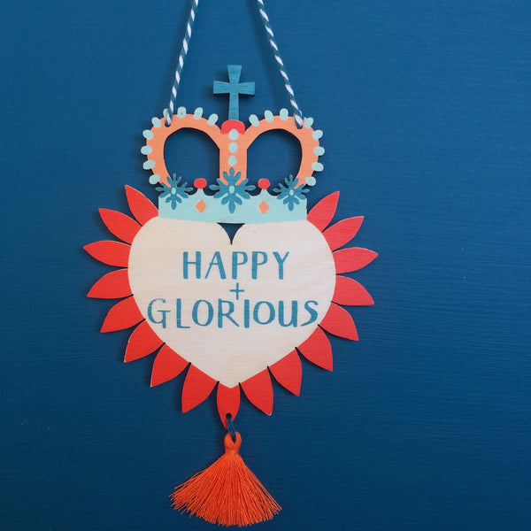 Laser cut and screen printed 'Happy + Glorious' Milagro charm by Fiona Biddington aka Paper Argonauts at Soma Gallery