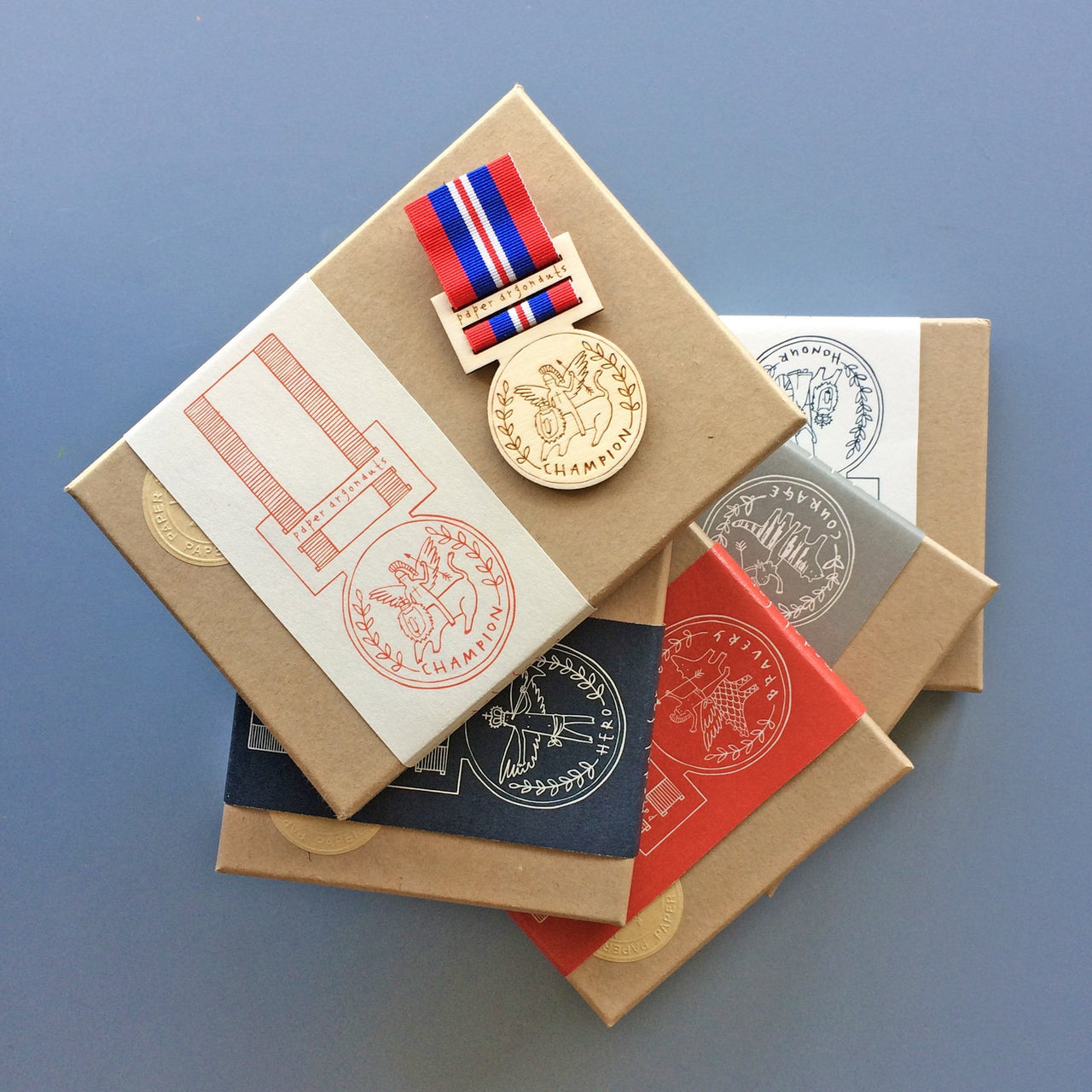 Limited edition wooden medals by Fiona Biddington aka Paper Argonauts at Soma Gallery
