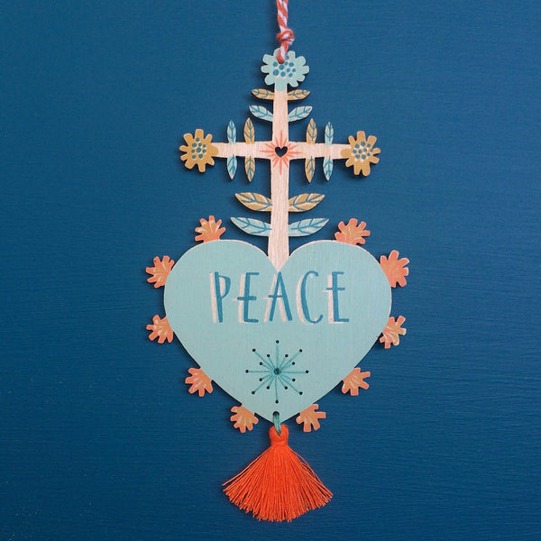 Laser cut and screen printed 'Peace' Milagro charm in aqua by Fiona Biddington aka Paper Argonauts at Soma Gallery