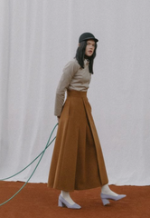 PLEATED VEGAN LEATHER SKIRT IN TOBACCO BROWN