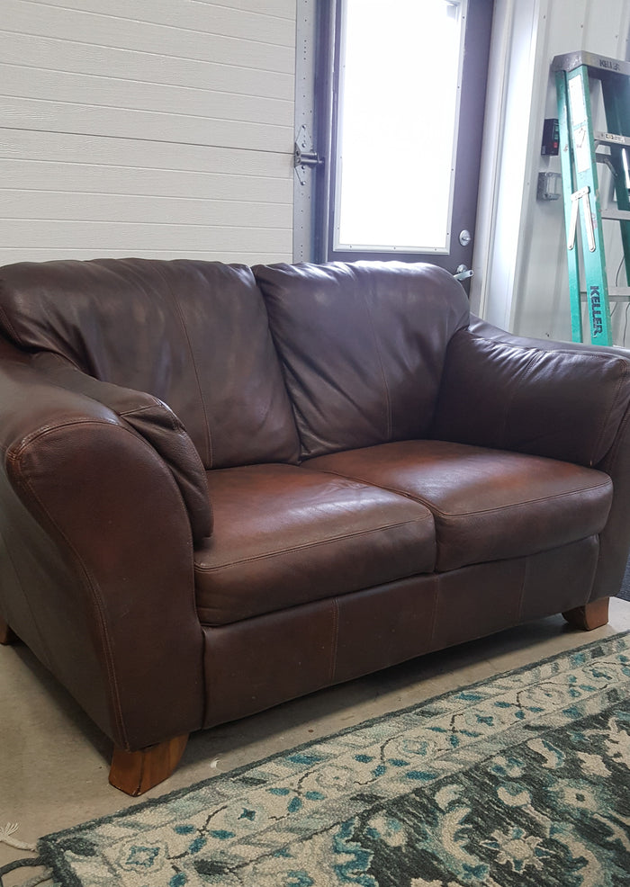 Leather style upholstered loveseat