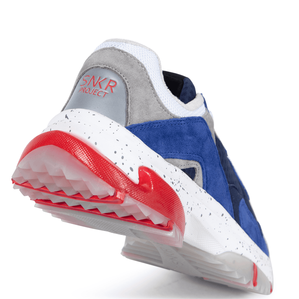 The Prospect Park men's luxury sneaker with grey, blue, white and red mesh and suede. Comfortable speckled trail sole.  clear sole of shoe