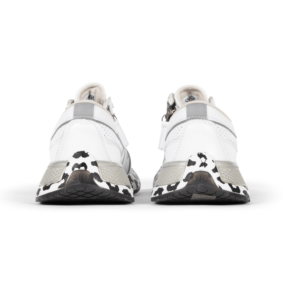 The white and silver Women's Rodeo 2.5 sneaker with animal print, reflective laces, a functional side zipper, perforated leather. Back of shoe