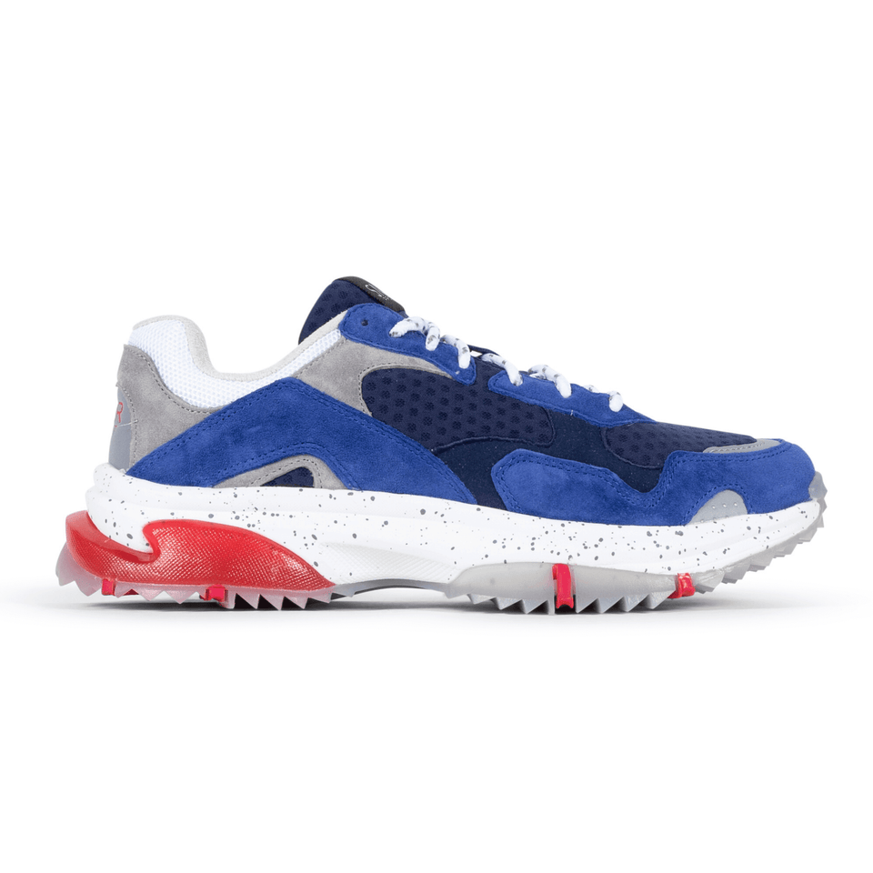 The Prospect Park men's luxury sneaker with grey, blue, white and red mesh and suede. Comfortable speckled trail sole. Side View