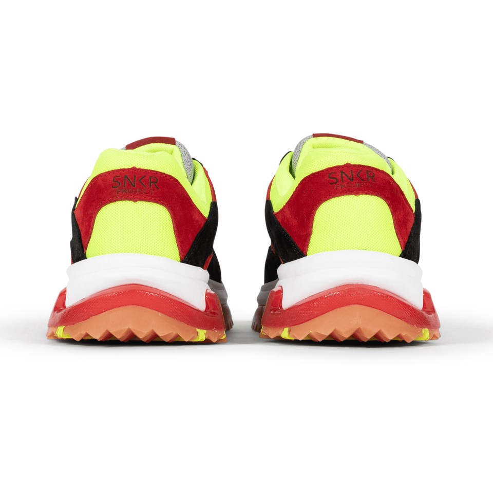 The Prospect Park men's luxury sneaker with grey, red, black and yellow mesh and suede. Comfortable gum trail sole. back of shoes