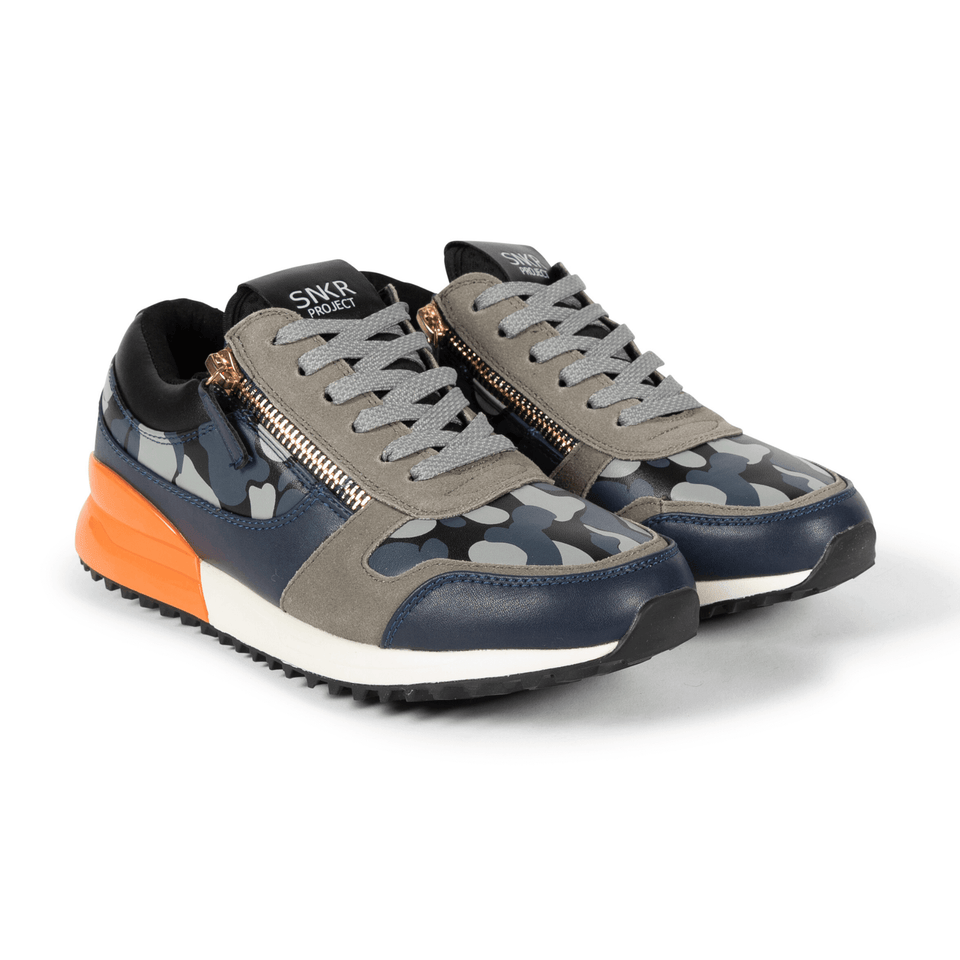 The Rodeo is a designer luxury mens sneaker. Navy Camo, orange, men's athleisure shoe with zips and suede. Two shoes next to each other.