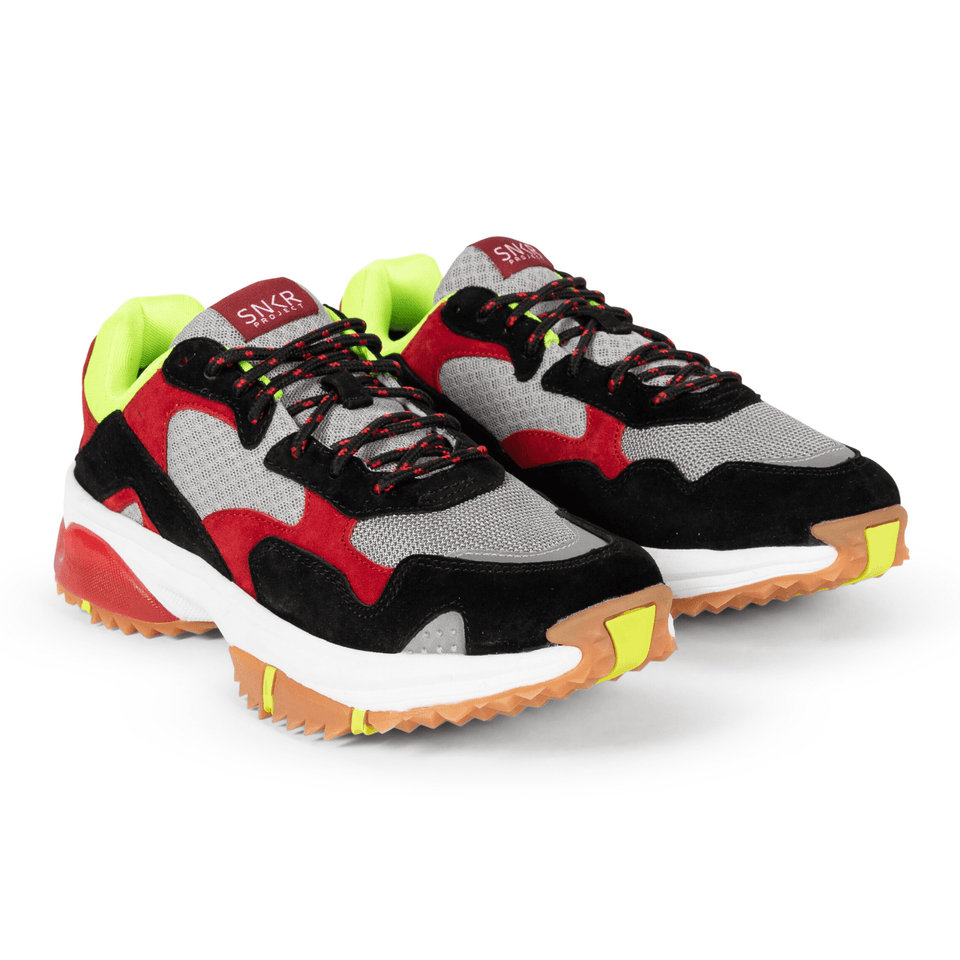 The Prospect Park men's luxury sneaker with grey, red, black and yellow mesh and suede. Comfortable gum trail sole.  two shoes