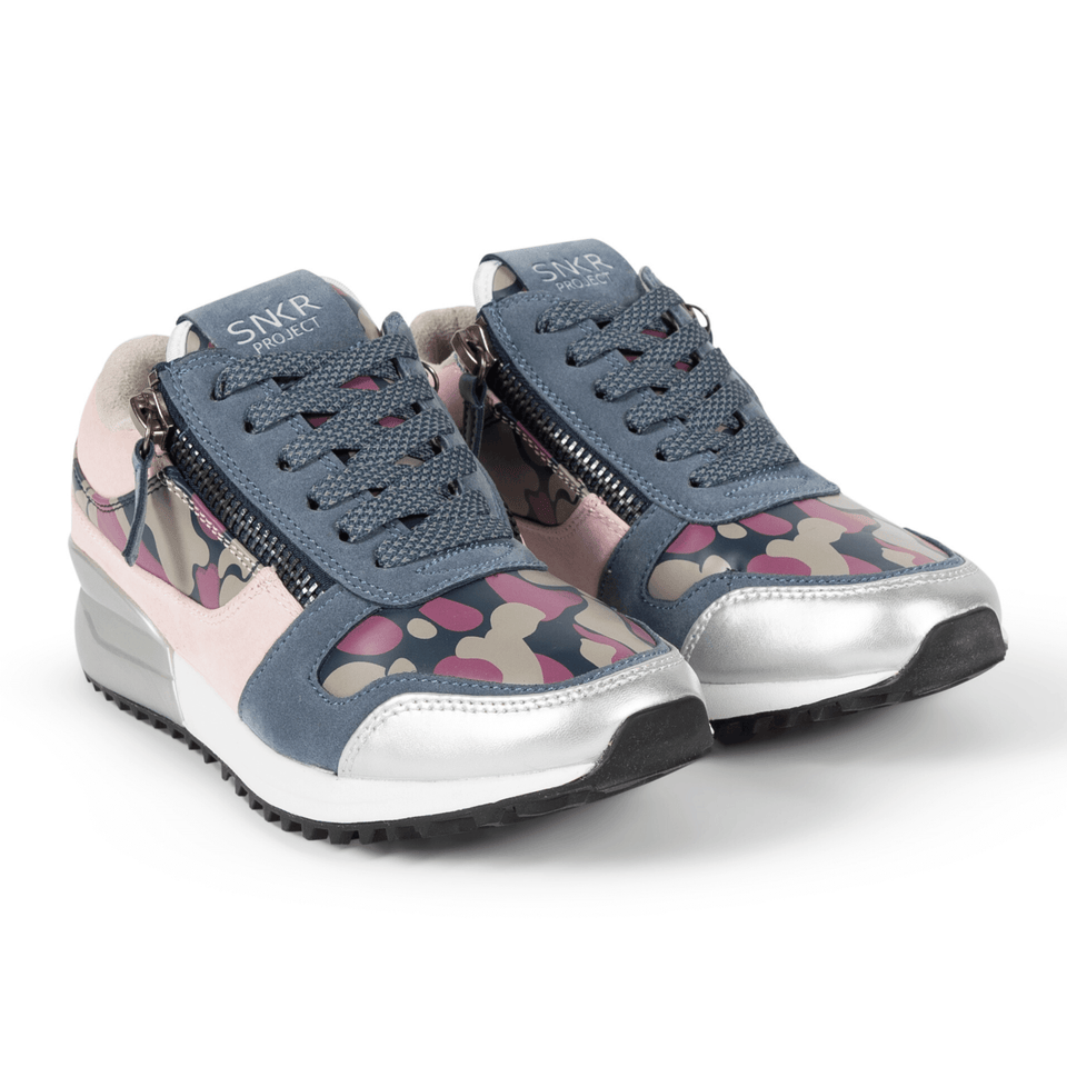 The Rodeo is a designer luxury purple suede, women's sneaker. This athleisure shoe features a custom sole, purple camo, and zippers. Double view.
