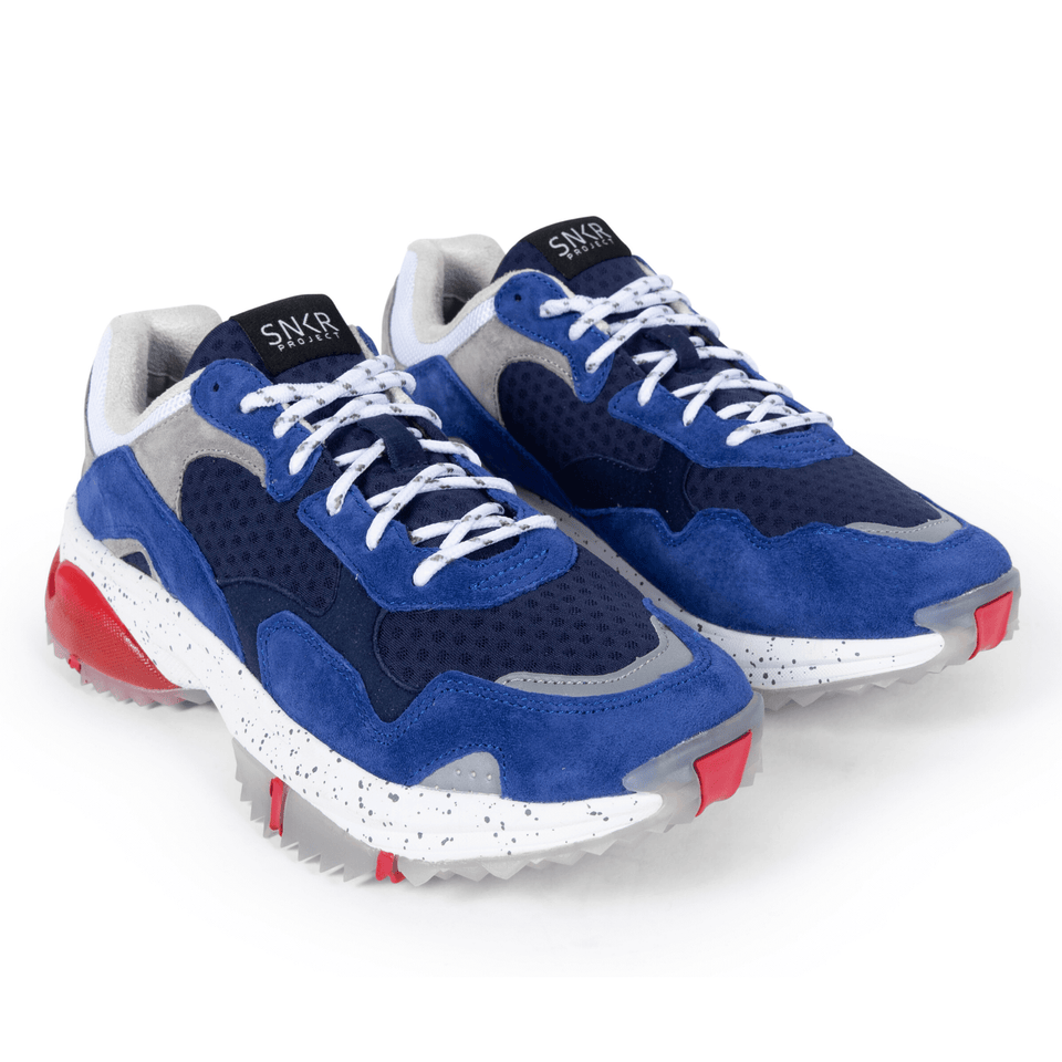 The Prospect Park men's luxury sneaker with grey, blue, white and red mesh and suede. Comfortable speckled trail sole.  two shoes