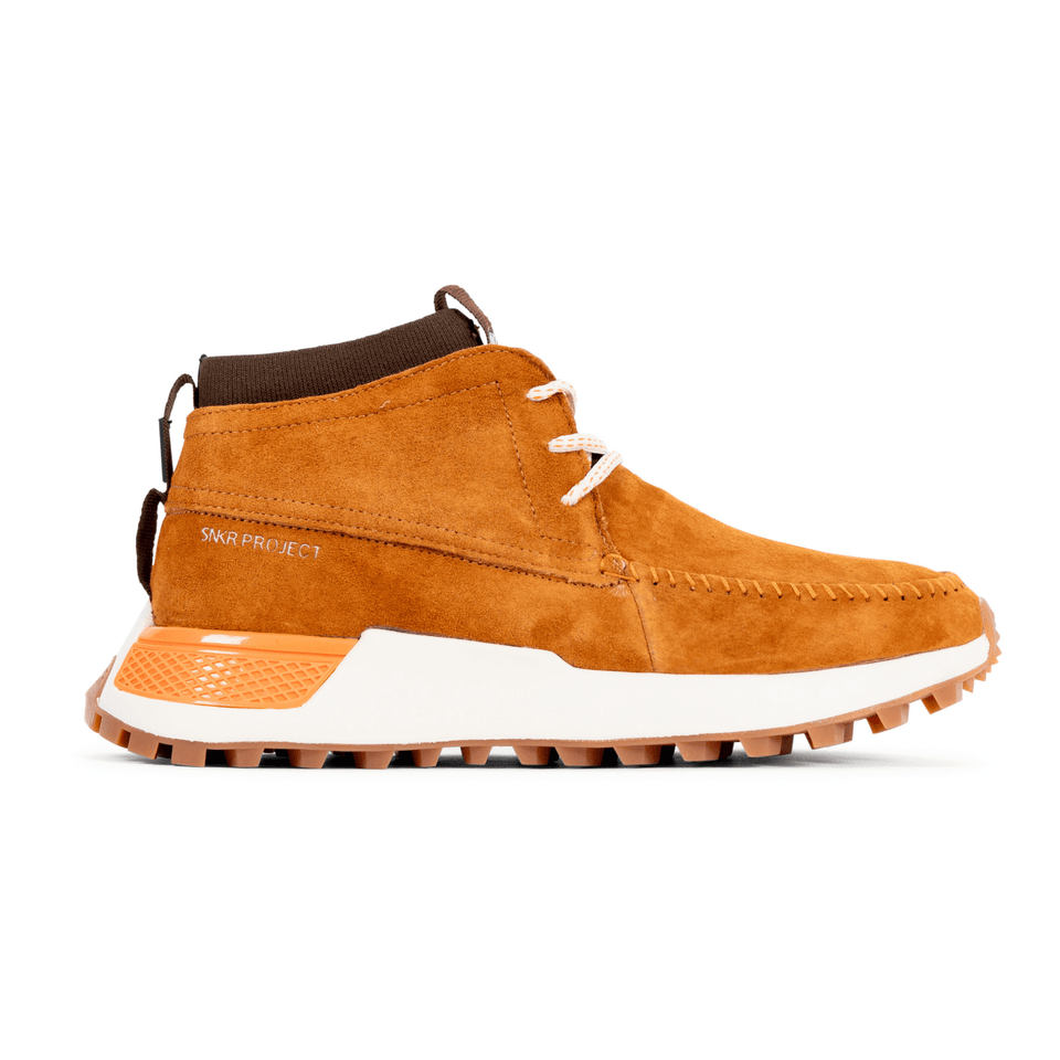 The Suffolk men's luxury sneaker boot with tan suede, white and gum sole and a brown sock-fit construction. Side View