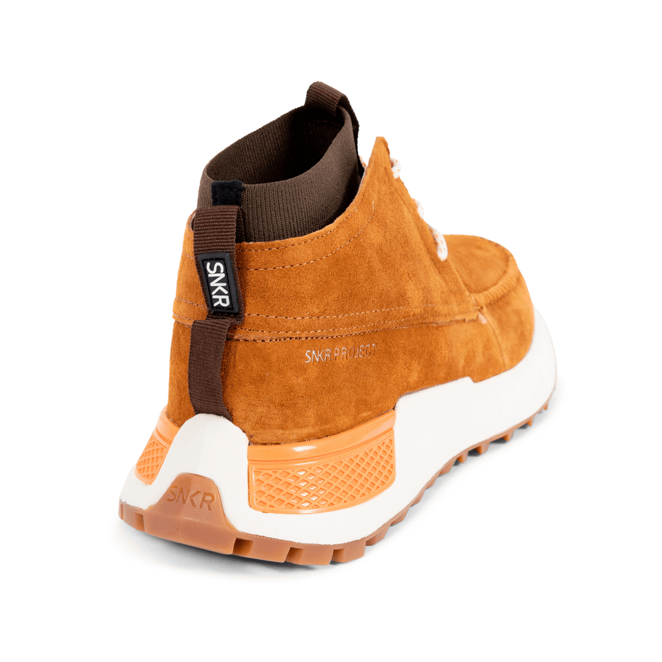 The Suffolk men's luxury sneaker boot with tan suede, white and gum sole and a brown sock-fit construction. Side and back of shoe