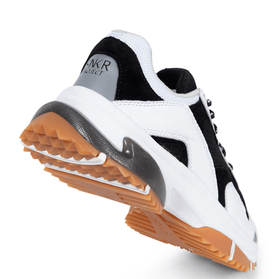 The Prospect Park men's luxury sneaker with black and white mesh and suede, silver accents. Comfortable gum trail sole. sole of shoe