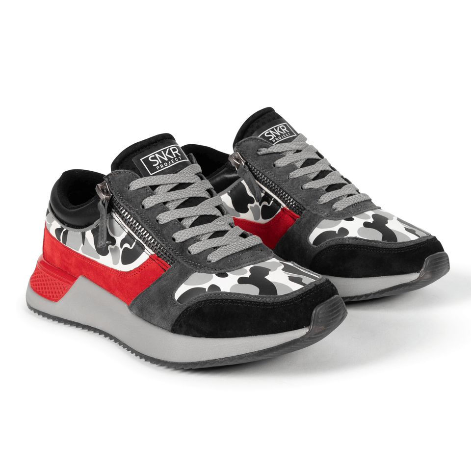 The men's Rodeo 2.5 sneaker, red, grey camo, reflective laces, a functional side zipper and suede. Two shoes