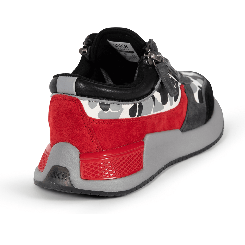 The men's Rodeo 2.5 sneaker, red, grey camo, reflective laces, a functional side zipper and suede. back view