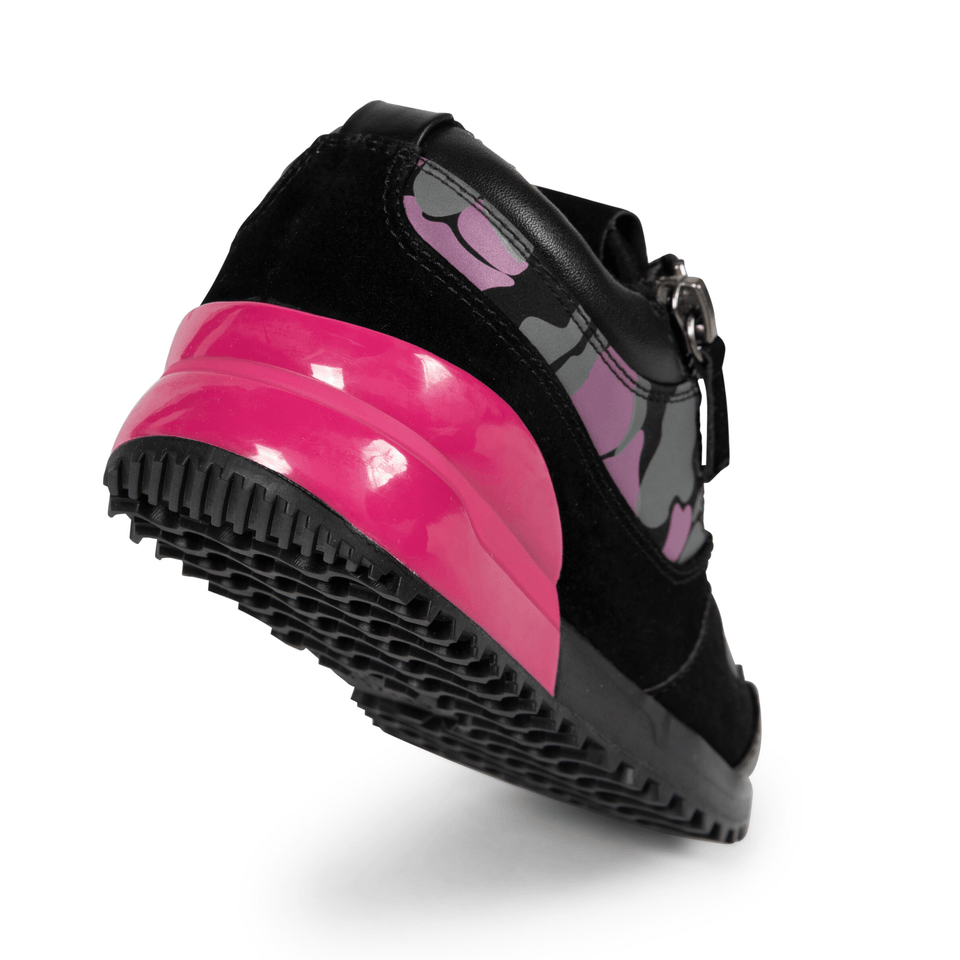 The Rodeo is a designer luxury black leather, women's sneaker. This athleisure shoe features a custom sole, pink camo, and zippers on the side. Sole of shoe