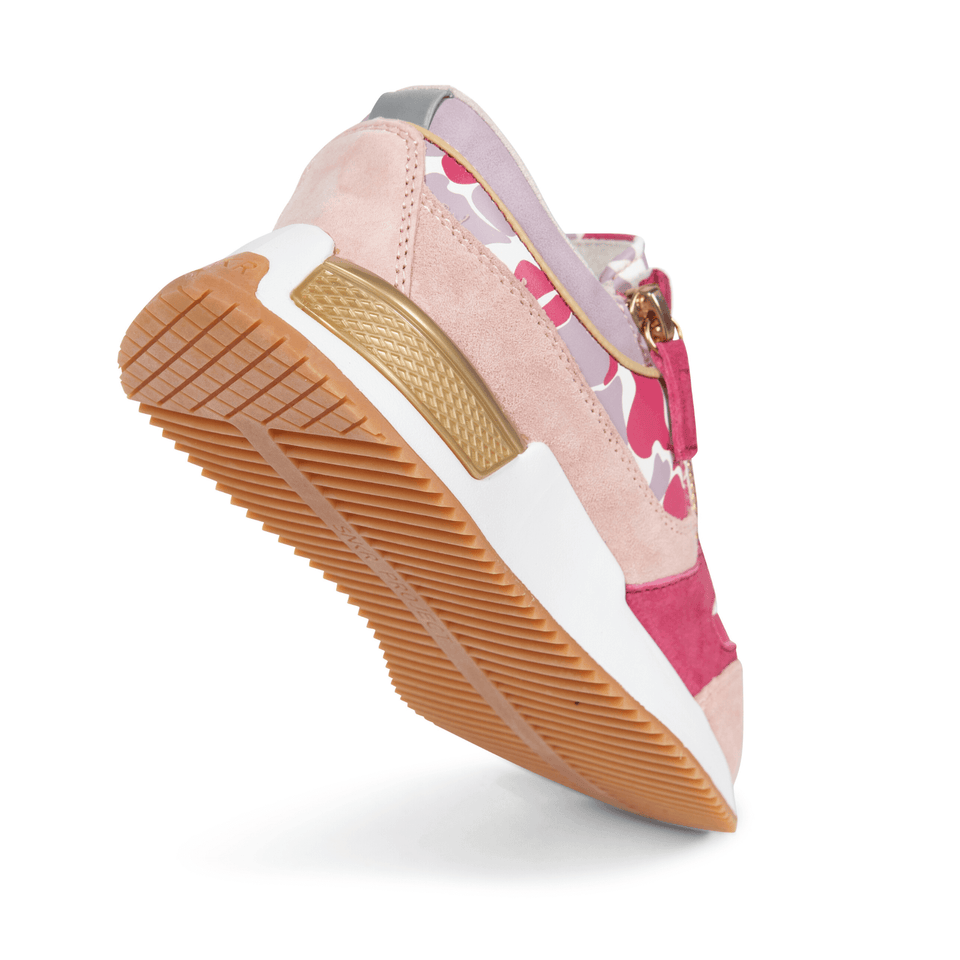 The gold and pink Women's Rodeo 2.5 sneaker, reflective laces, a gold functional side zipper, lavender suede. sole view