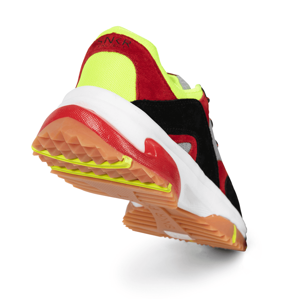 The Prospect Park men's luxury sneaker with grey, red, black and yellow mesh and suede. Comfortable gum trail sole. sole of shoes