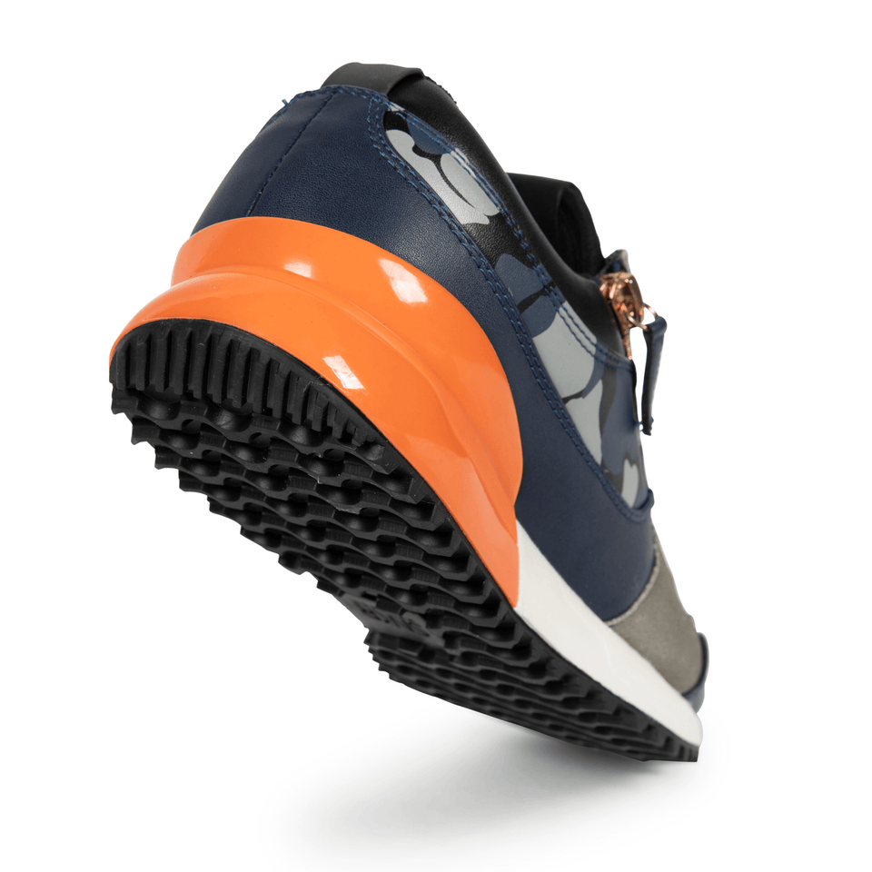 The Rodeo is a designer luxury mens sneaker. Navy Camo, orange, men's athleisure shoe with zips and suede. Sole image.