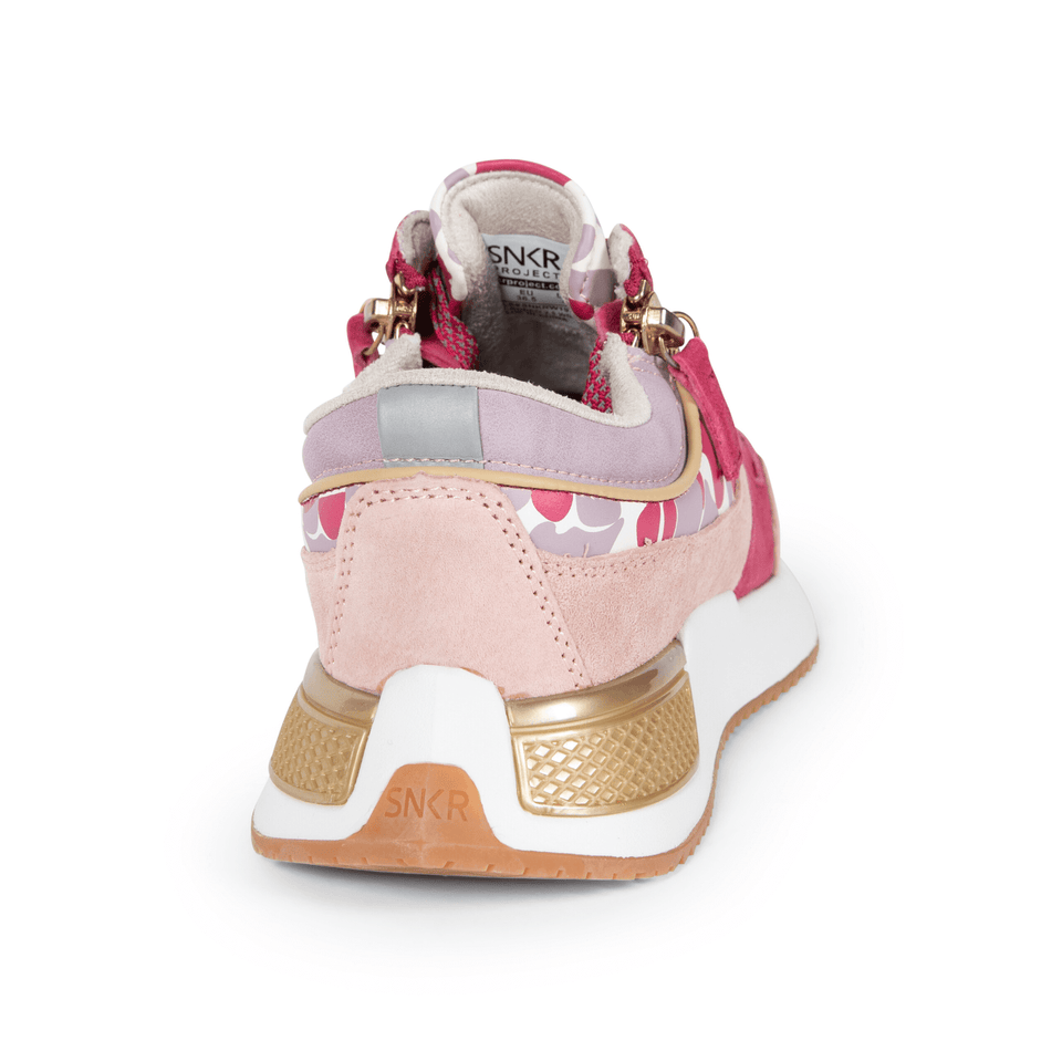 The gold and pink Women's Rodeo 2.5 sneaker, reflective laces, a gold functional side zipper, lavender suede. back and side view