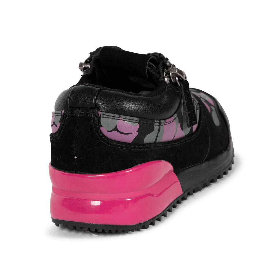 The Rodeo is a designer luxury black leather, women's sneaker. This athleisure shoe features a custom sole, pink camo, and zippers on the side. Back and side view