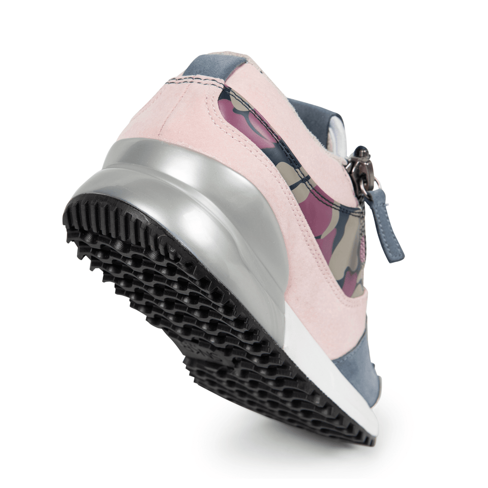 The Rodeo is a designer luxury purple suede, women's sneaker. This athleisure shoe features a custom sole, purple camo, and zippers. sole view.