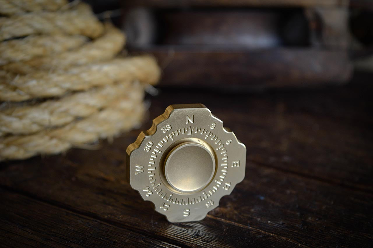 Lodestar Spinner Intro, Brass Compass Design