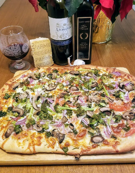 garlic olive oil pizza with fresh tomatoes and veggies