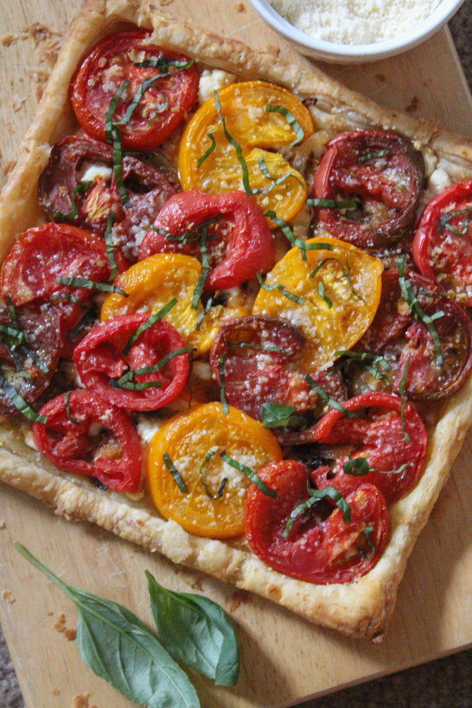 heirloom tomato tart with goat cheese and caramelized onions