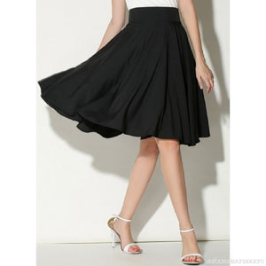 This skirt is knee length and pleated - madrushfashion.com