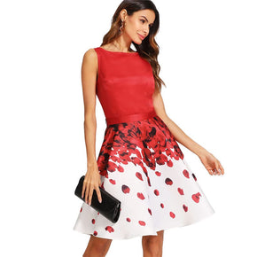 Red Sleeveless Top And Rose Petal Print Skirt Set