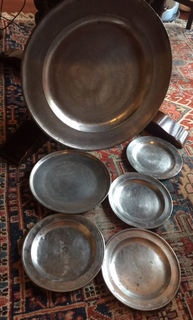 18th century English pewter charger and (4) plates including (1) continental bonus plate.