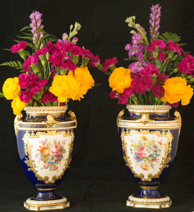 Two Albert Gregory signed Royal Crown Derby vases from the 1890-1921 production years. Measure 9.5