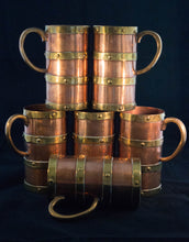 Circa 1890 set of six copper mugs with four bands of brass and ear-form handle stack profile Greenans Cottage decorative arts and antiques Virginia USA