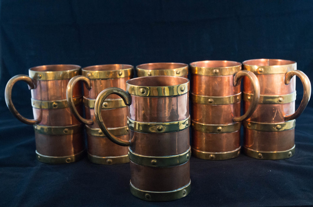 Circa 1890 set of six copper mugs with four bands of brass and ear-form handle face presentation Greenans Cottage decorative arts and antiques Virginia USA