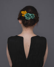 Timeless silk blossom flower hair comb in shades of vintage green and mustard