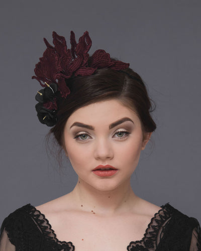 Statement lace fascinator featuring dramatic guipure lace flowers in burgundy shades