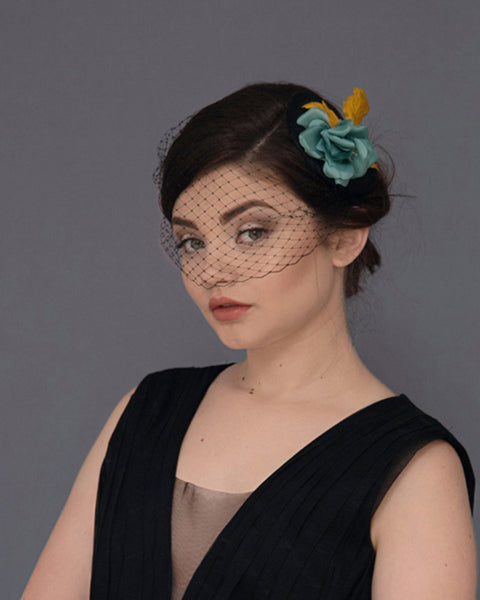 Silk flower birdcage veil hat in black, vintage green and mustard shades