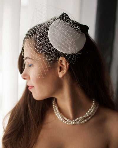 Bridal bow fascinator, mini cocktail hat adorned with french veil and a delicate black bow