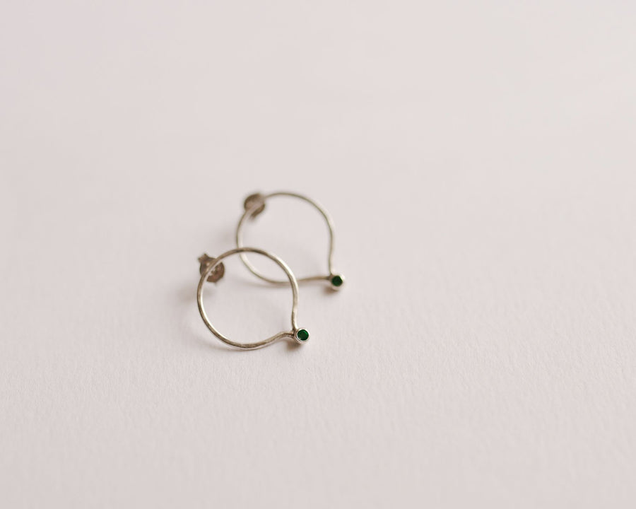 Flowing circle emerald earrings